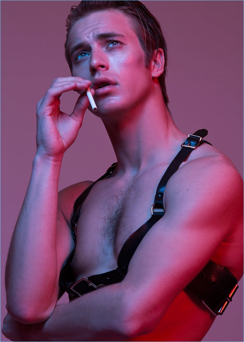Appearing in an editorial for Lui Italia, Jules Raynal wears a Zara Bayne leather harness.
