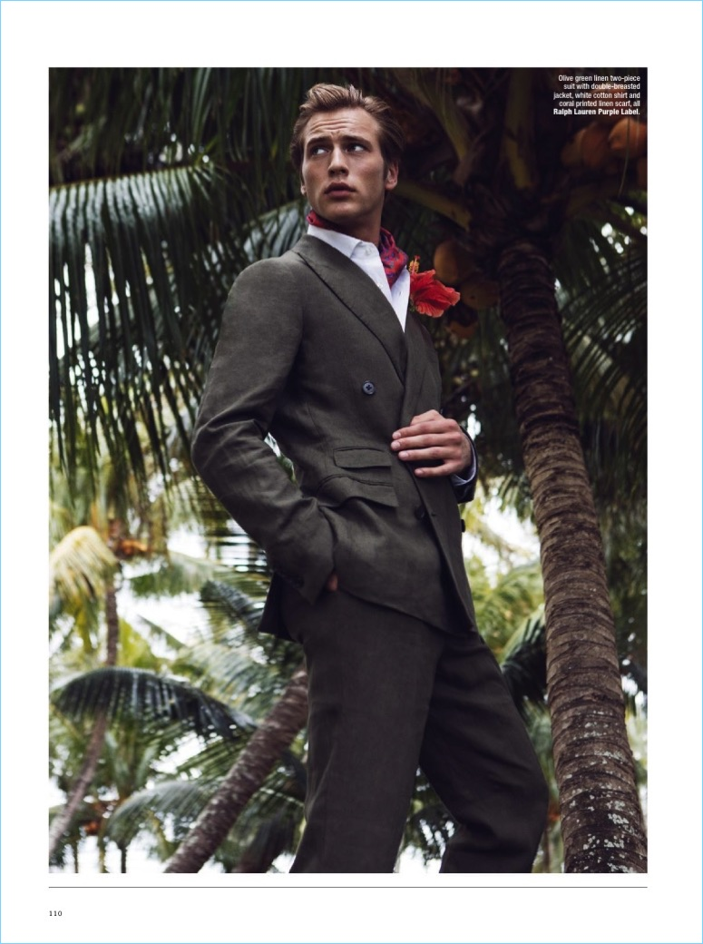 Jules Raynal wears an olive green linen suit with a shirt and printed linen scarf by Ralph Lauren Purple Label.