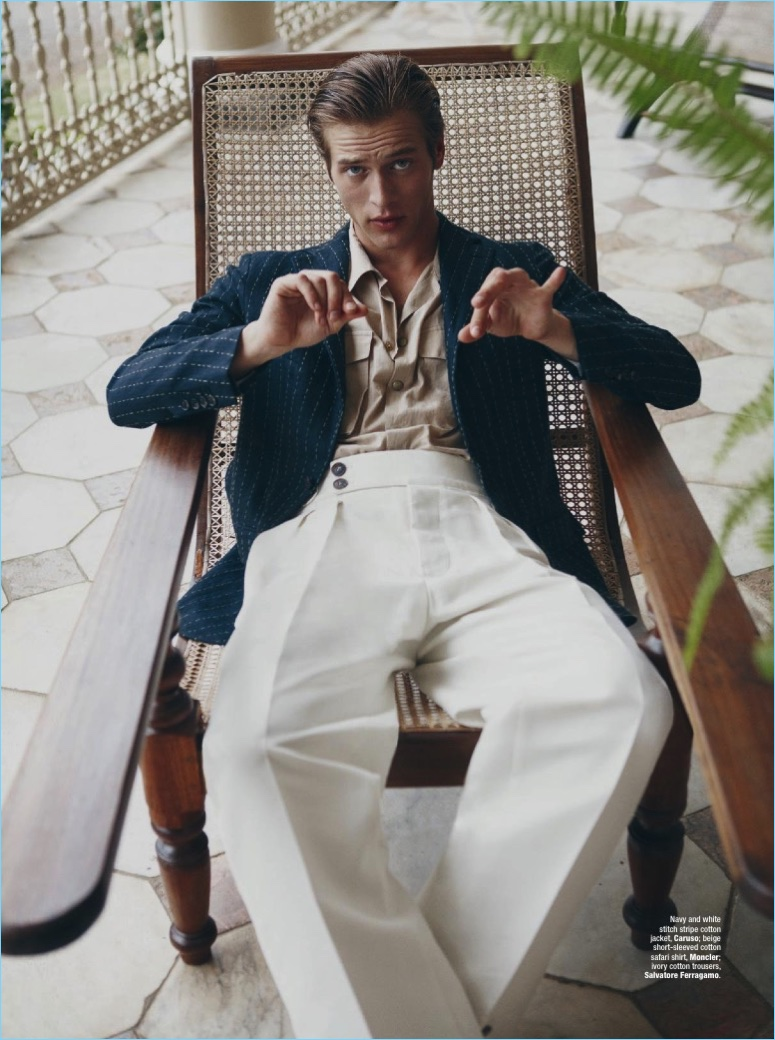 Model Jules Raynal sports a Caruso jacket with a Moncler shirt and Salvatore Ferragamo trousers.