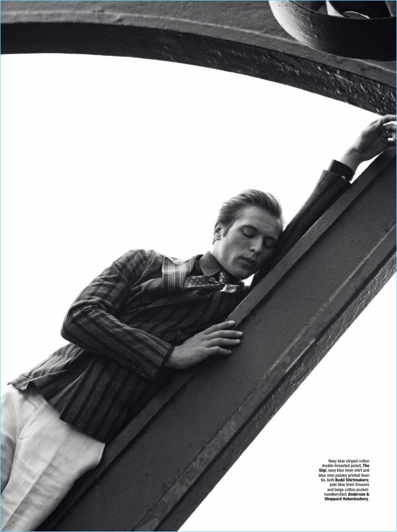 Appearing in a black and white image, Jules Raynal wears a double-breasted jacket by The Gigi with a shirt and paisley tie from Budd Shirtmakers. Jules also sports an Anderson & Sheppard Haberdashery handkerchief.