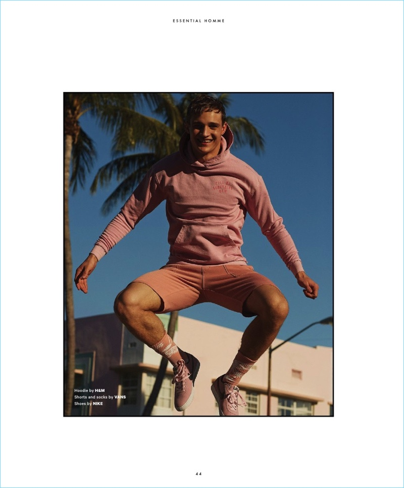 Jumping for joy, Julian Schneyder wears a hoodie by H&M with shorts and socks by Vans. Julian also sports Nike shoes.