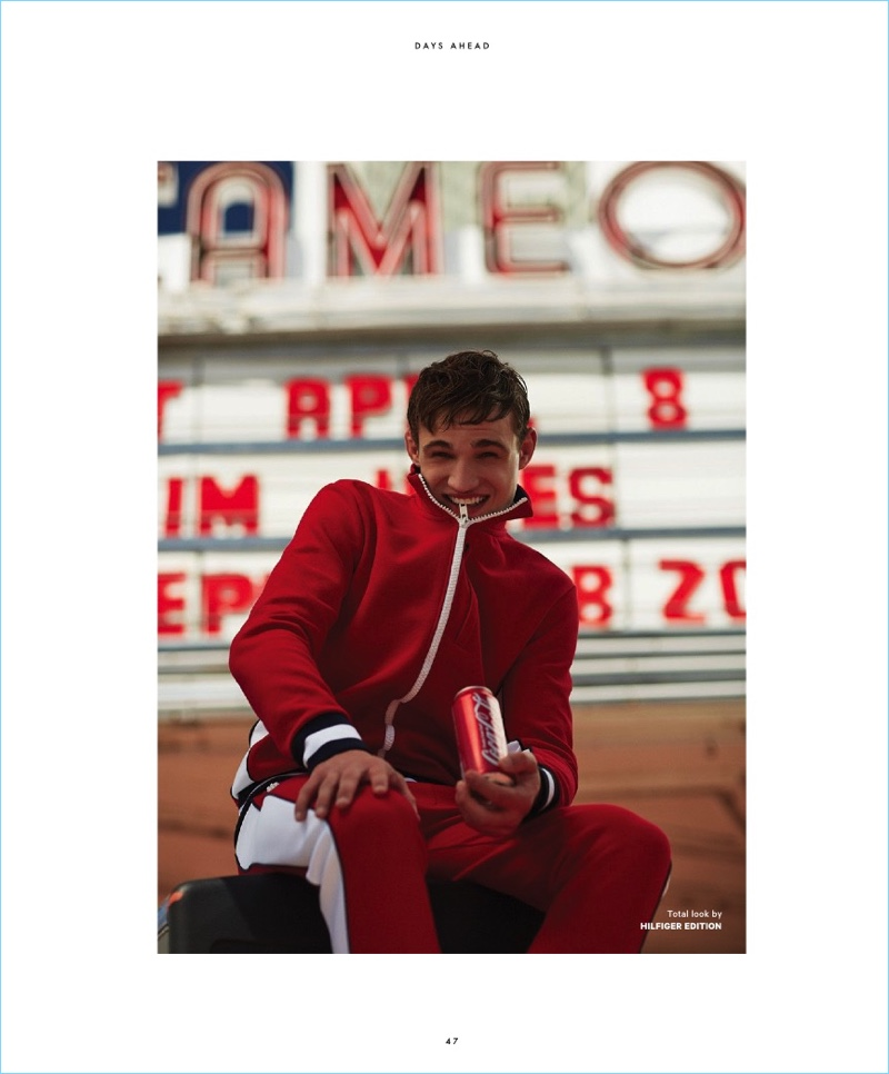 All smiles, Julian Schneyder rocks a red tracksuit by Hilfiger Edition.