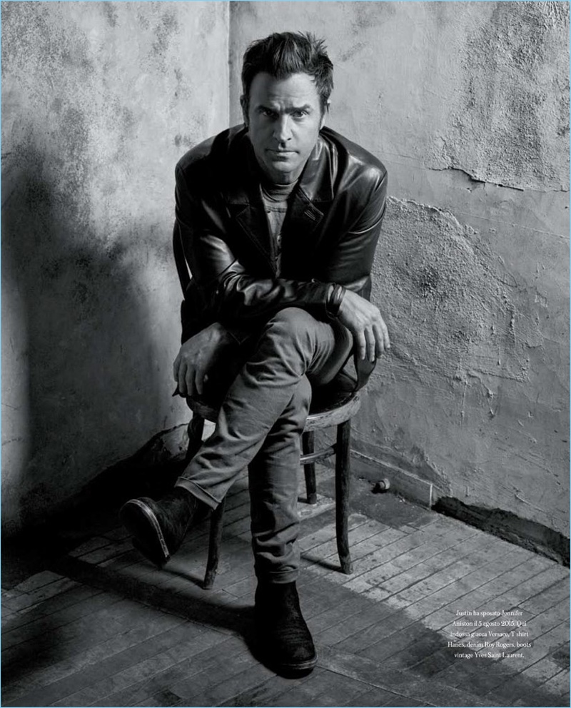 Front and center, Justin Theroux wears a Versace leather jacket with a Hanes t-shirt, Roy Rogers jeans, and vintage Yves Saint Laurent boots.