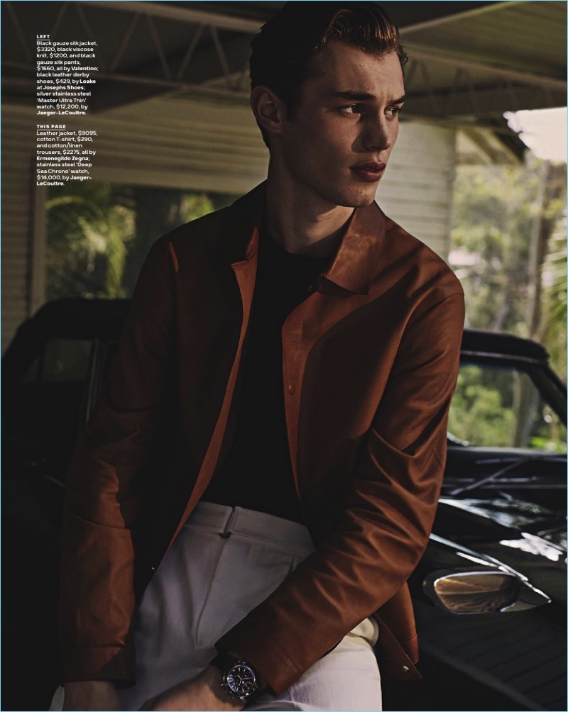 Kit Butler wears a brown leather jacket, t-shirt, and linen trousers by Ermenegildo Zegna. The British model also sports a Jaeger-LeCoultre watch.