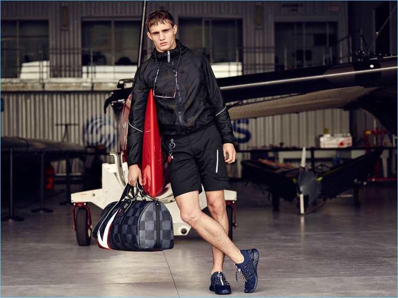 296d69beea19 Julian Schneyder models a sporty look from Louis Vuitton s 2017 America s  Cup collection.