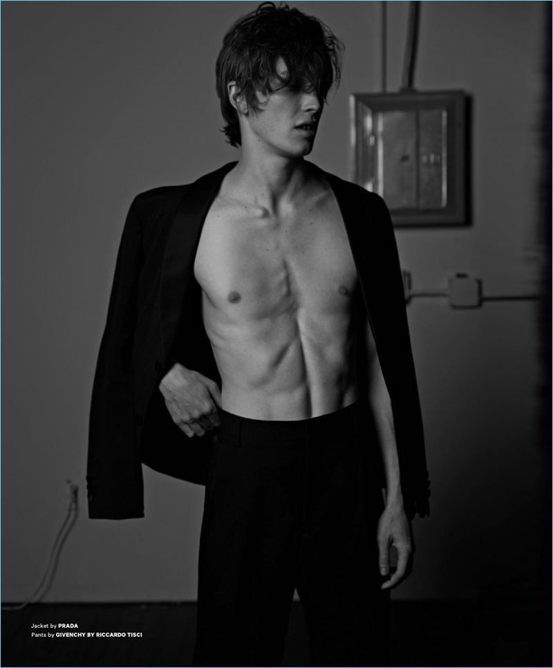 Model Lucas Satherley dons a Prada jacket with Givenchy trousers.