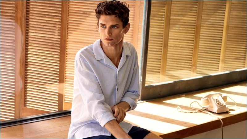 A summer vision, Arthur Gosse sports a Mango Man linen-blend shirt $69.99 and contrast trim swim shorts $49.99.