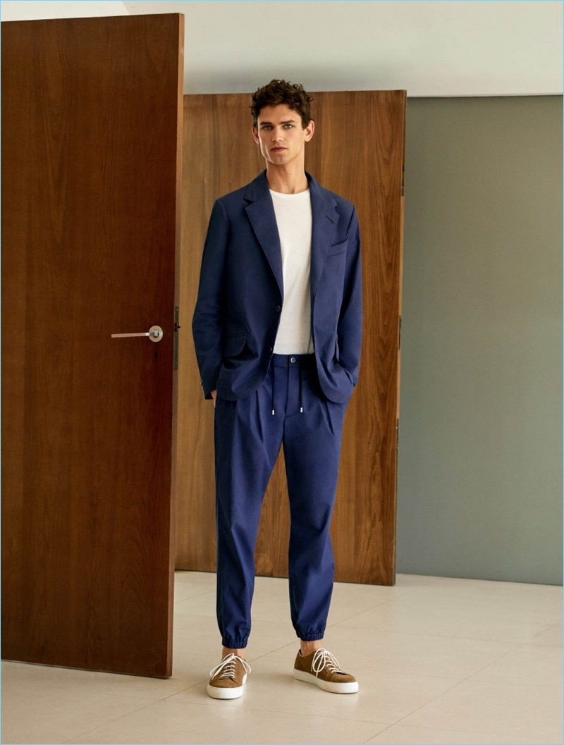 Front and center, Arthur Gosse wears a Mango Man unstructured suit blazer $199.99 and trousers $69.99. The French model also dons a Mango Man essential cotton-blend t-shirt $15.99 and lace-up suede sneakers $99.99.