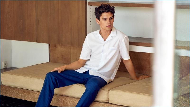Relaxing, Arthur Gosse wears a Mango Man regular fit cotton linen-blend shirt $69.99 and wool-blend cropped trousers $89.99.