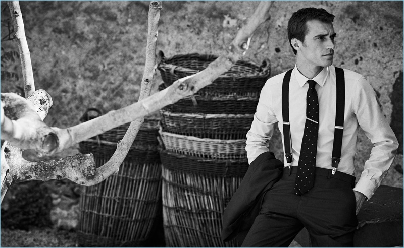 French model Clément Chabernaud wears a smart shirt and trousers with suspenders from Massimo Dutti.