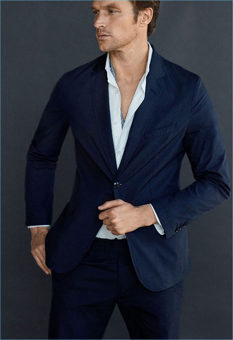 Shaun DeWet dons a navy cotton suit with a slim-fit blazer by Massimo Dutti.