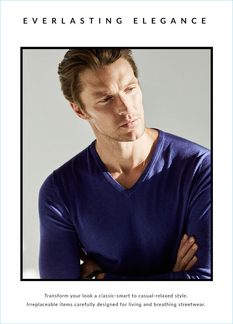 Model Shaun DeWet sports a v-neck sweater from Massimo Dutti.