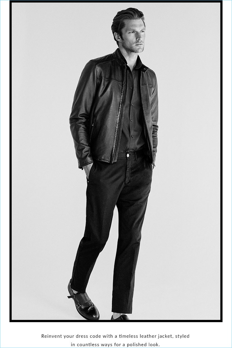A casual but sleek vision, Shaun DeWet wears a leather jacket, cotton shirt, and pleated pants from Massimo Dutti.