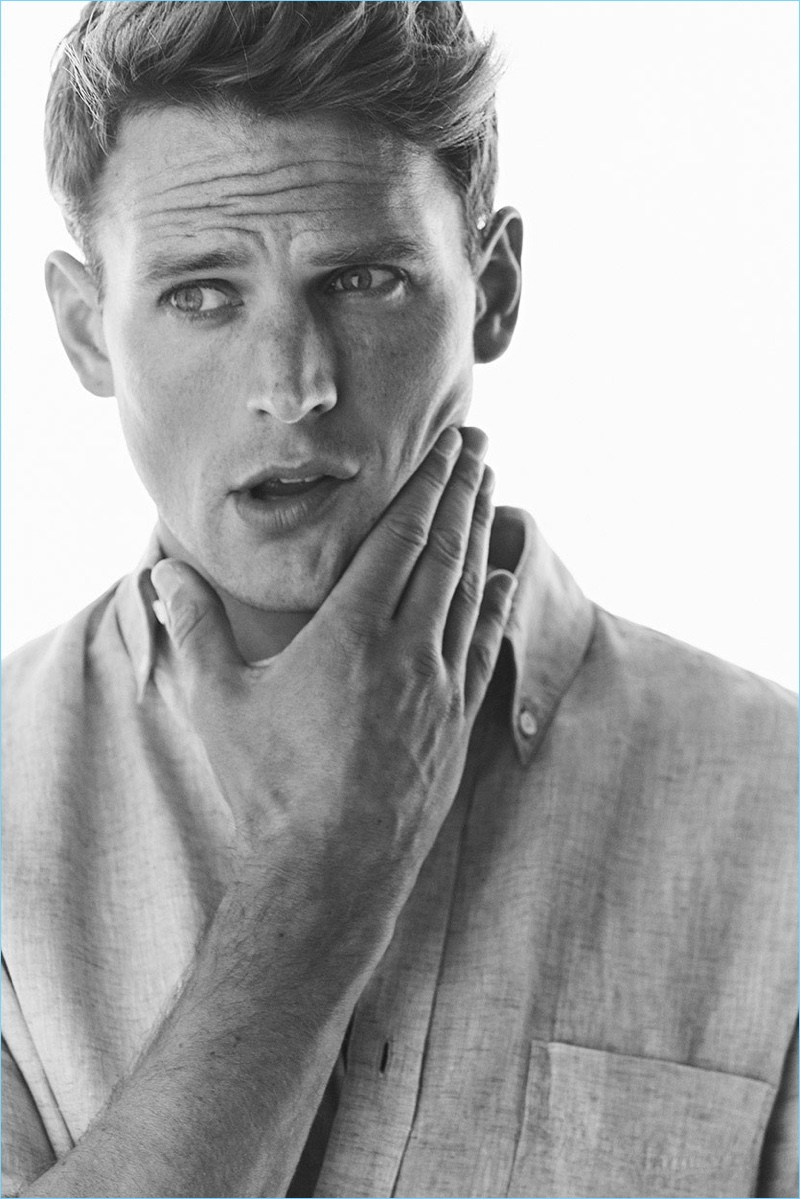 Appearing in a black and white photo, Guy Robinson wears a linen shirt by Massimo Dutti.