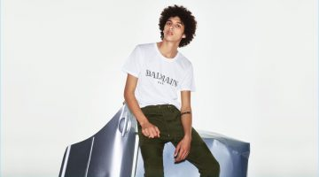 The logo trend is alive and well as Jackson Hale rocks a Balmain logo-print cotton T-shirt, and biker cotton track pants.