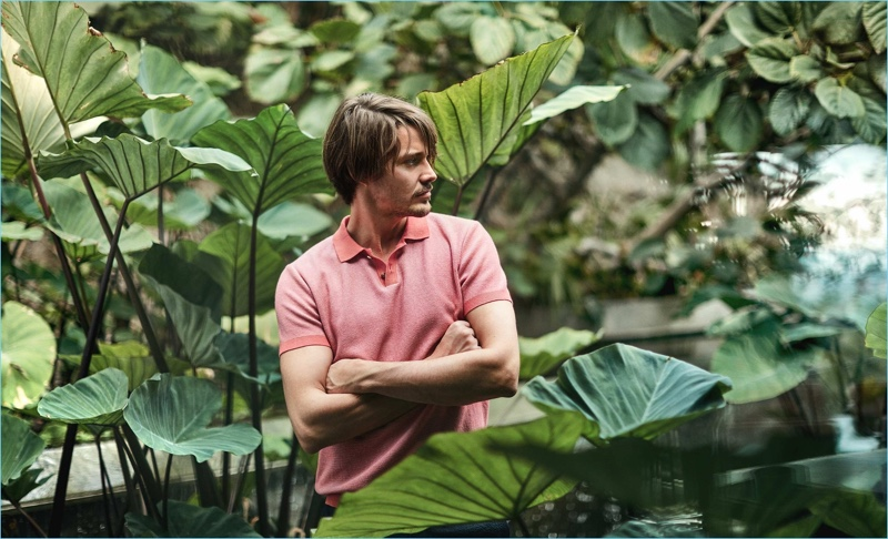 Front and center, Rob Moore wears an Orley polo $372 with Orlebar Brown shorts $181.