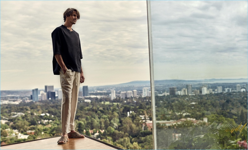 Simon Chilvers outfits Rob Moore in a Barena Venezia t-shirt $143 and Loewe trousers $743.