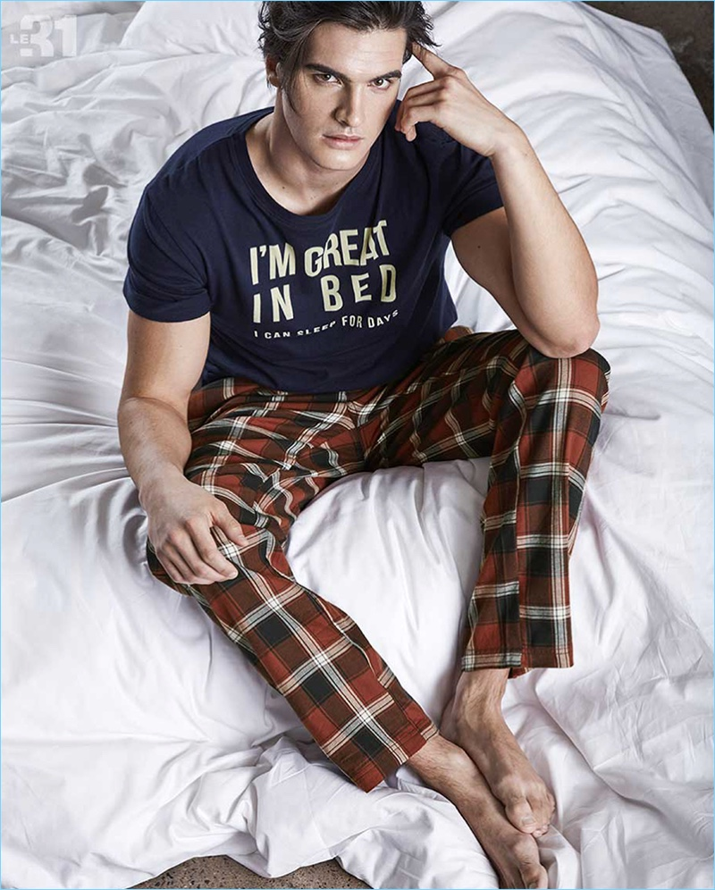 Taking it easy, Matthew Terry sports pajama pants and a cheeky t-shirt from LE 31.