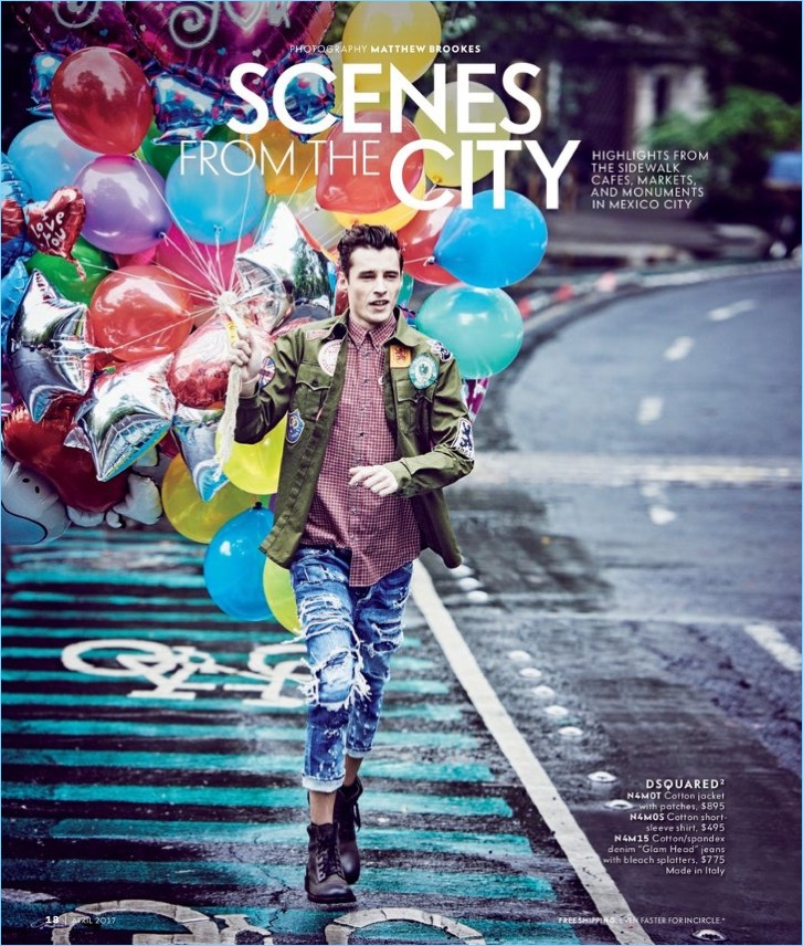 Adrien Sahores takes to the streets of Mexico City with a bouquet of balloons. The French model wears a campy spring look from Dsquared2.