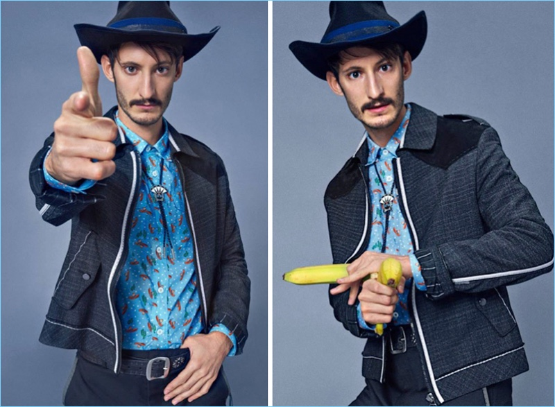 Making a western statement, Pierre Niney wears a jacket and pants by Lanvin. Niney also sports a Prada shirt, Dsquared2 belt, and Maison Michel hat.