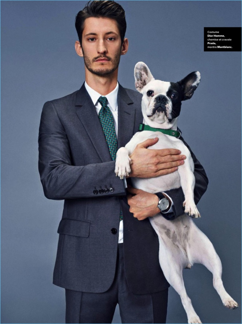 Actor Pierre Niney suits up in Dior Homme. He wears a Prada shirt and tie with a Montblanc watch.