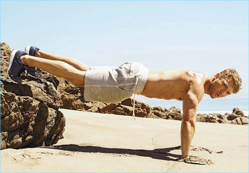 Starring in a Men's Fitness photo shoot, Ryan Phillippe does a decline pushup.