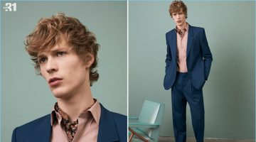 Sven de Vries wears LE 31's retro navy suit with a stretch shirt and brown dress shoes.
