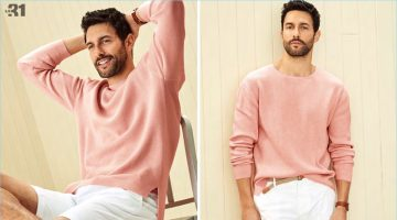 All smiles, Noah Mills sports a pink pastel drop-shoulder sweater with braided-belt chino Bermudas from LE 31. He also wears Paul Smith white sneakers and a Skagen Holst watch.