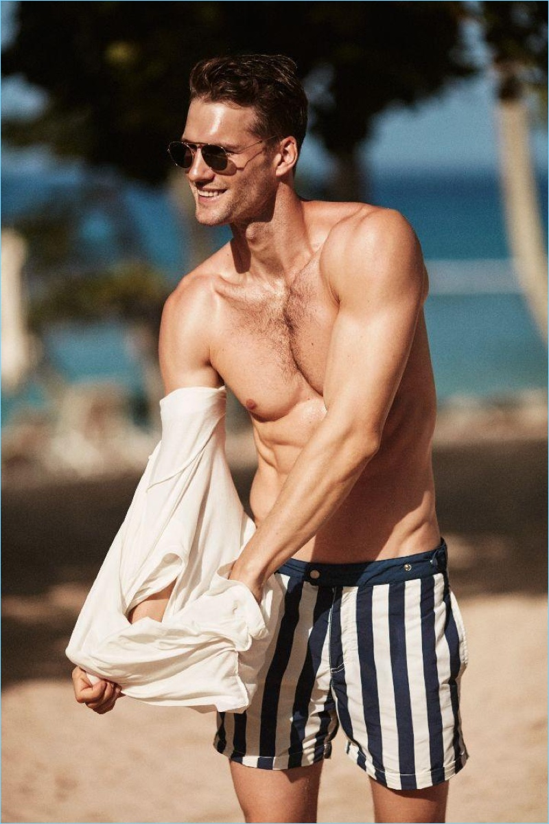 Tomas Skoloudik wears striped swim shorts from Solid & Striped.