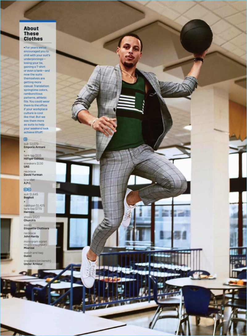 Reaching great heights, Steph Curry wears an Emporio Armani check suit with a Hilfiger Edition tank, and UAS sneakers.