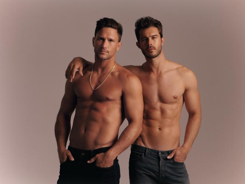 Tyler Wood and Alex Prange pose shirtless in denim jeans.