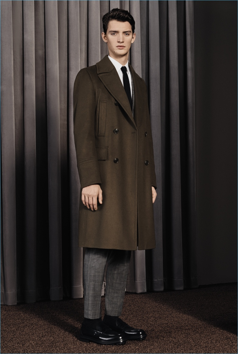 Otto Lotz models a smart coat and suit from BOSS' fall-winter 2017 travel collection.