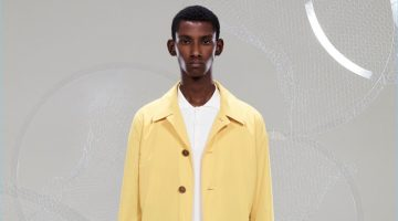 Model Myles Dominique sports a standout yellow coat from Canali's spring-summer 2018 collection.