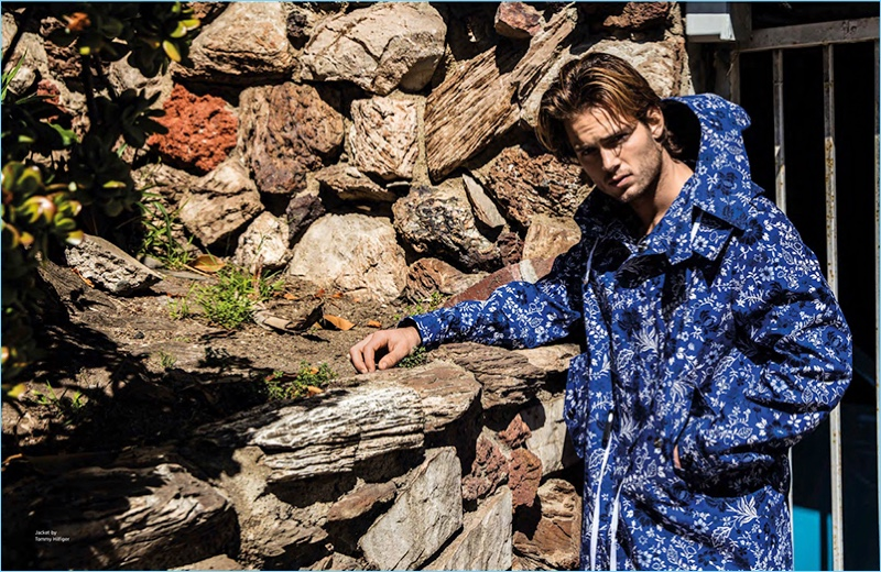 Venturing outdoors, Chad James Buchanan wears an all-over print Tommy Hilfiger parka.