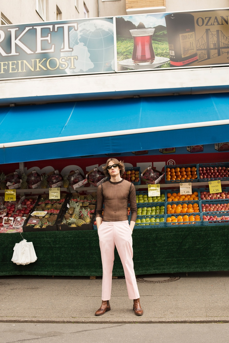 Carl wears top Jean Paul Gaultier, vintage trousers, boots and sunglasses Gucci.