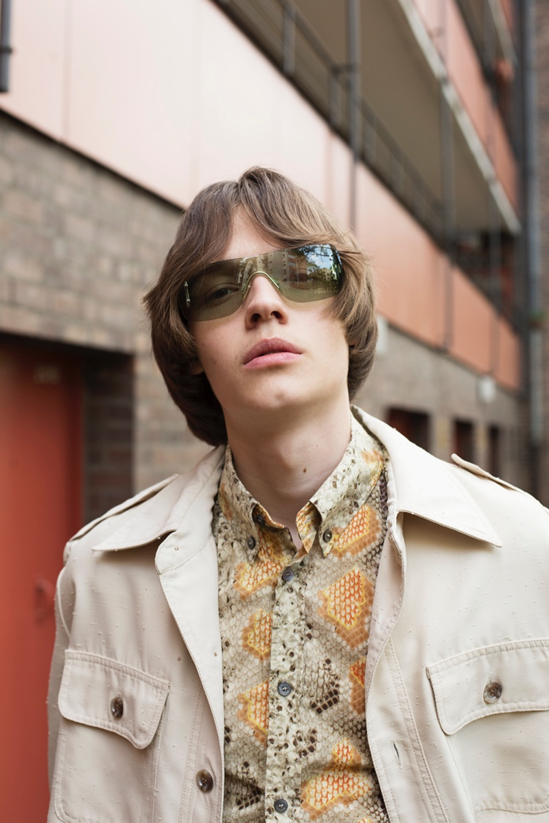 Carl wears shirt John Galliano, jacket Christian Dior, and sunglasses Gucci.