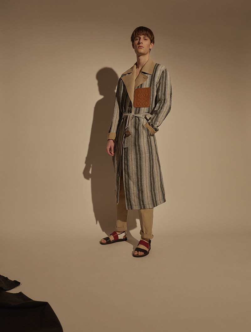 Thomas wears trench Loewe, trousers Levi's Made & Crafted, and sandals Camper.