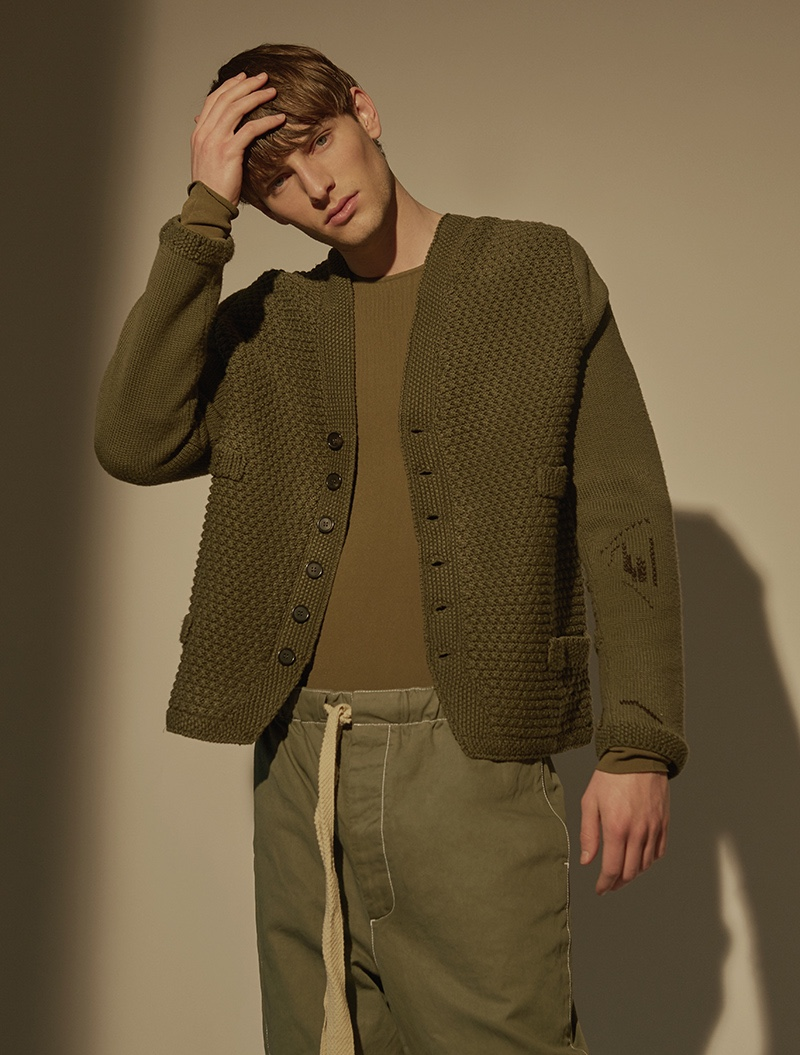 Thomas wears cardigan, pullover, and trousers Loewe with sneakers Hogan.