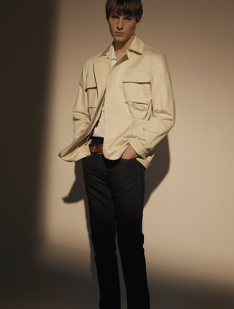 Thomas wears jacket Lacoste, polo Dsquared2, jeans Levi's, and belt Just Cavalli.