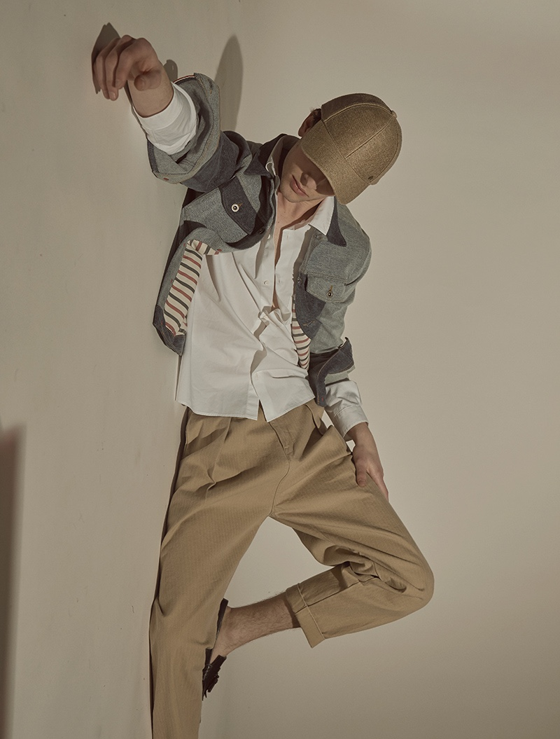 Thomas wears shirt COS, jacket Tommy Hilfiger, trousers Levi's Made & Crafted, cap Esprit, and shoes Tod's.
