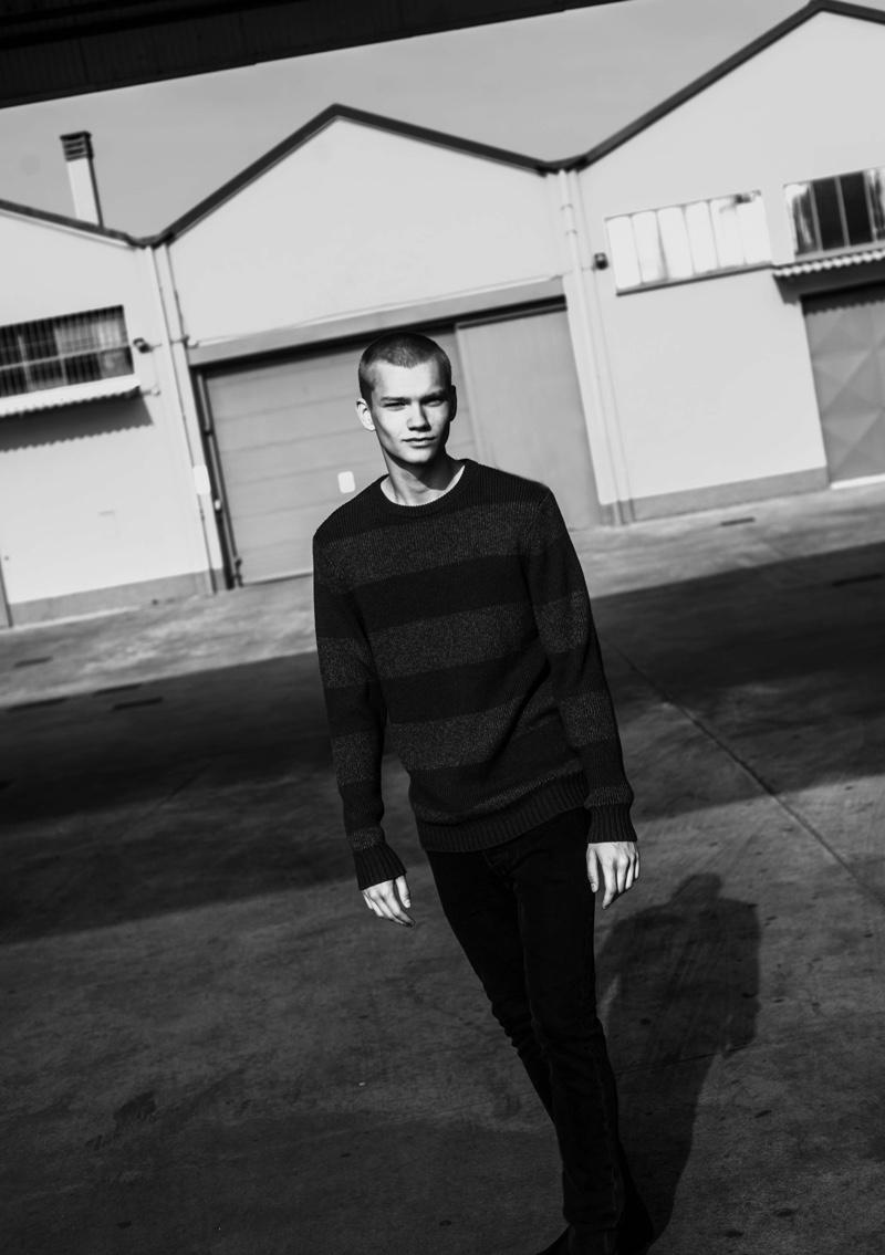 Jordy Gerritsma sports a Levi's striped sweater and black denim jeans.