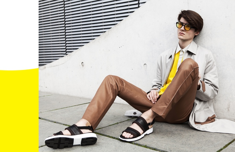 A luxurious vision, Elvis Jarrs wears Lunettes Kollektion sunglasses with a look from Hermès.