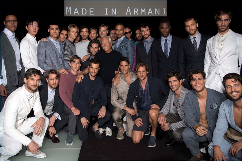 Designer Giorgio Armani poses for photos with the models who participated in his spring-summer 2018 namesake label show.
