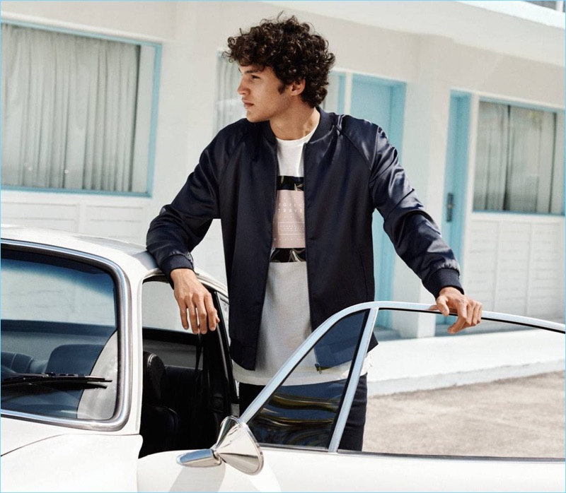 Connecting with H&M, Francisco Henriques sports an embroidered bomber  jacket $59.99, graphic tee $12.99