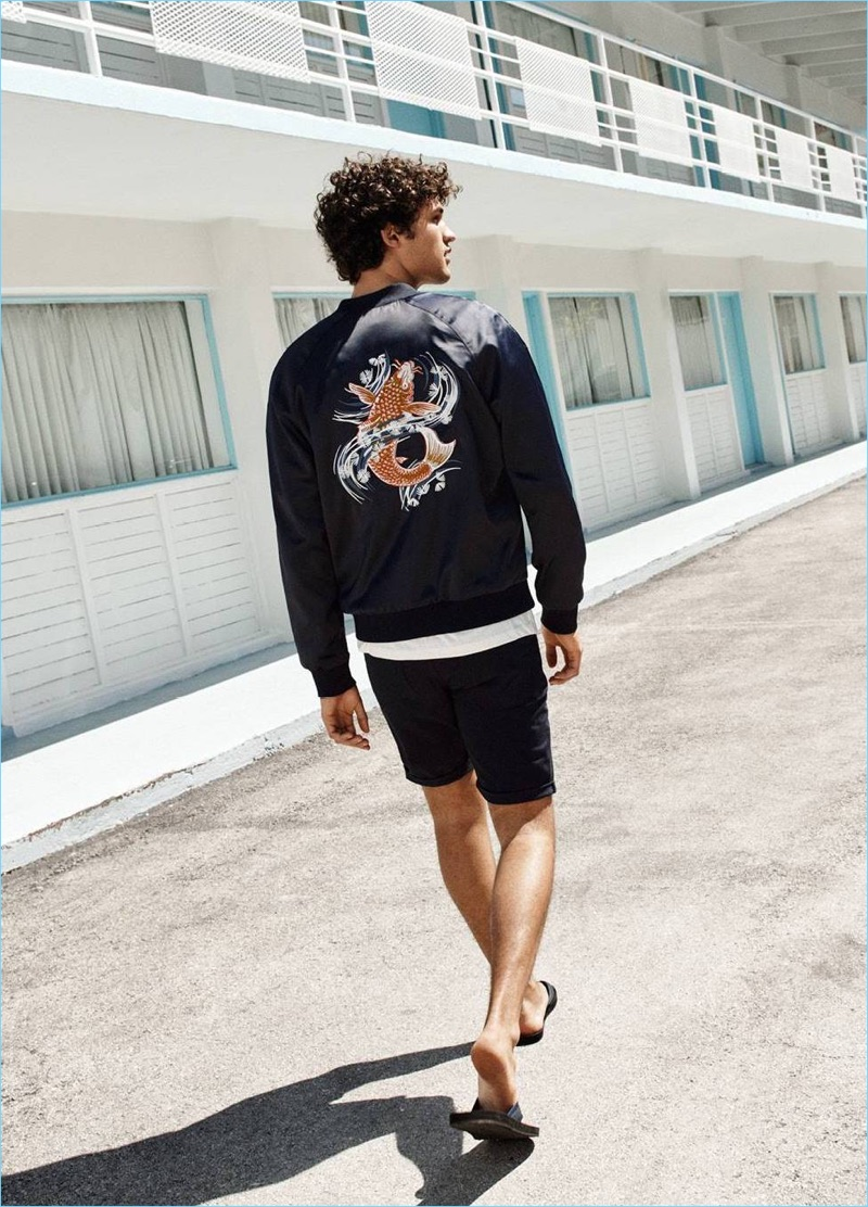 Embracing casual summer style, Francisco Henriques wears a H&M embroidered  bomber jacket $59.99, twill