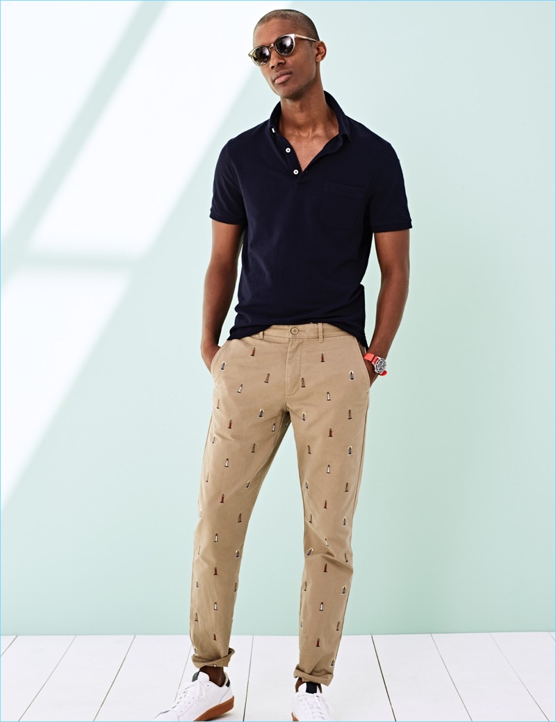 Piqué Polos: Claudio Monteiro models a J.Crew piqué polo shirt $45 with pants, sunglasses $99.99, and New Balance sneakers $75.