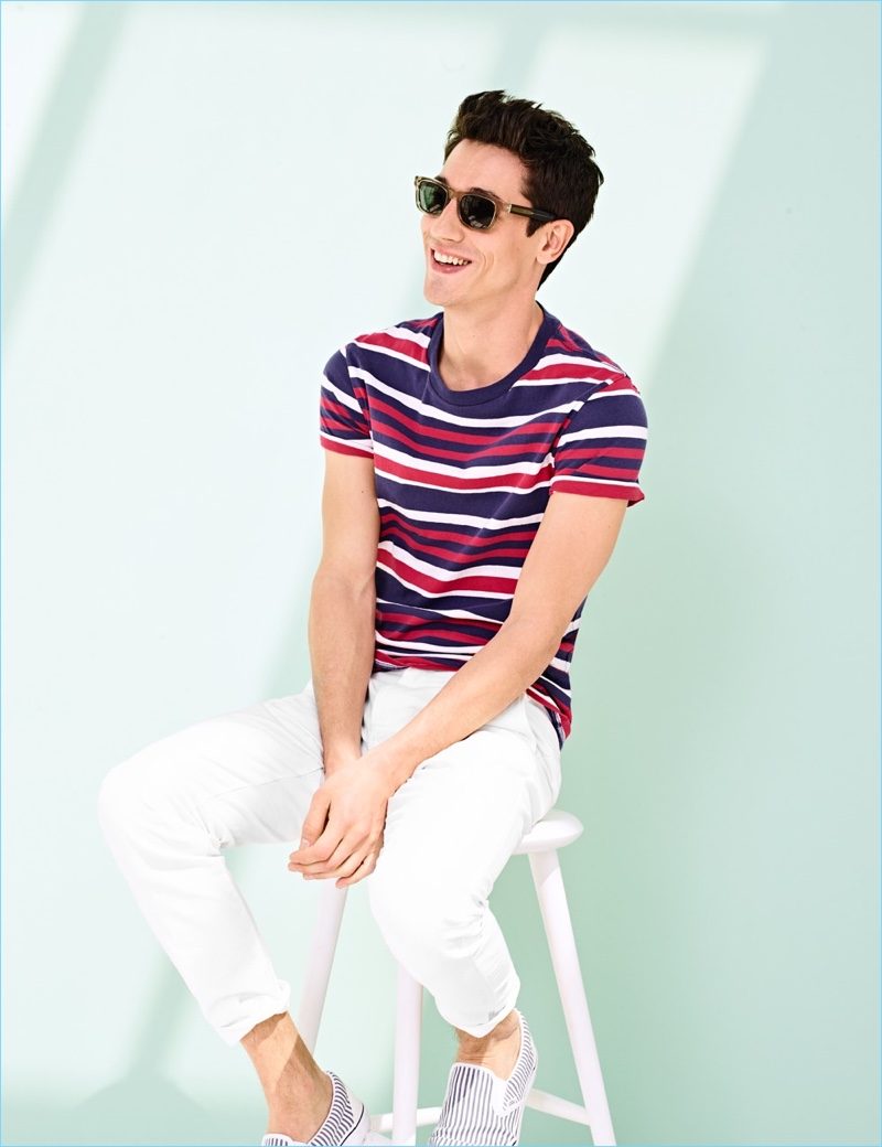 Striped Tees: Nicolas Ripoll wears a J.Crew striped cotton tee $45, chinos $75, sunglasses $118, and striped Vans slip-on sneakers $60.