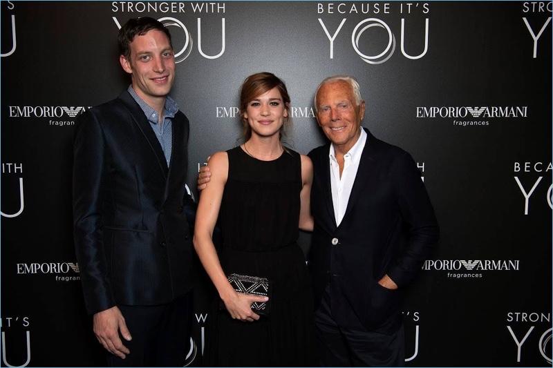 Designer Giorgio Armani poses for photos with James Jagger and Matilda Lutz at Emporio Armani's fragrance launch event.