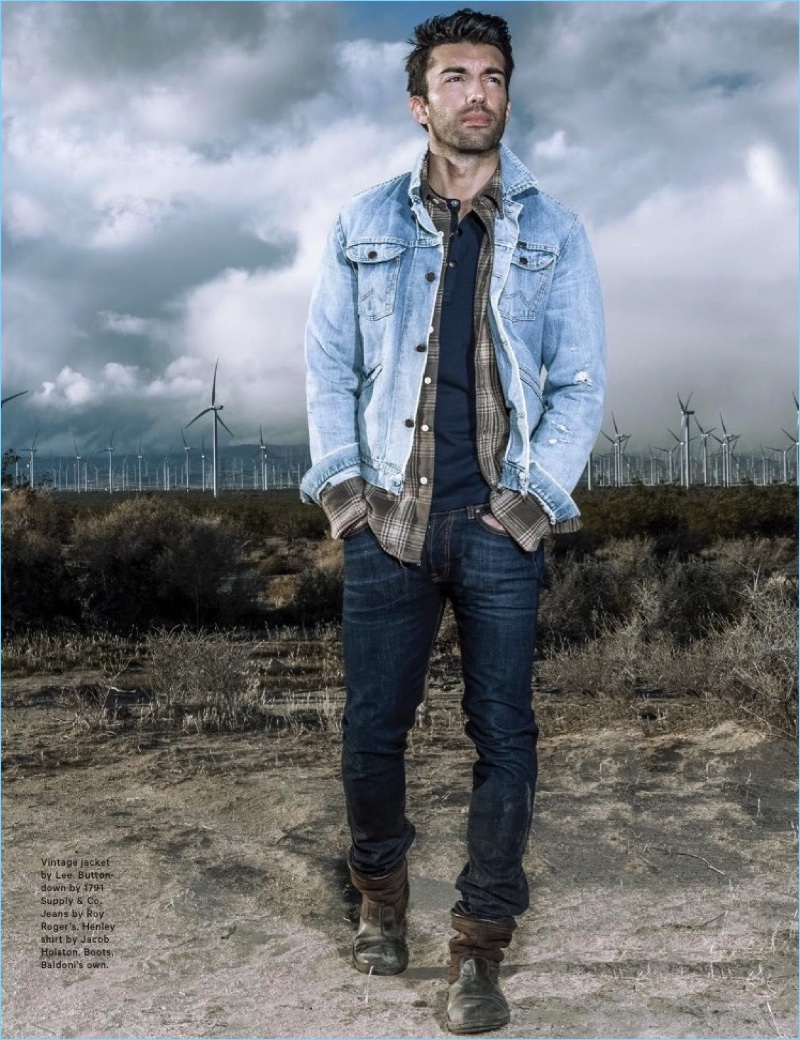Embracing double denim, Justin Baldoni wears a vintage denim jacket by Lee. He also sports a 1791 Supply & Co. button-down, Roy Roger's jeans, and Jacob Holston henley. Baldoni rocks his own boots.