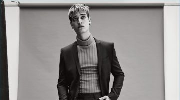 Jonathan Bellini dons a suit by The Kooples with a Gucci turtleneck sweater and Balenciaga boots.